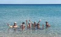Kust zwemmen Helmen Sardinie Fietsreis Italie